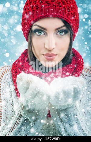 Santa Women holding snowflake - Stock Image
