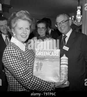 Prime Minister Margaret Thatcher with Lord Sinsbury and an armful of environmentally-friendly products at the Better Environment awards for industry presentation in London. - Stock Image