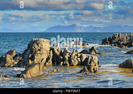 Rock formations in the sea near Hovsund on island Gimsøy on Lofoten in Norway. - Stock Image
