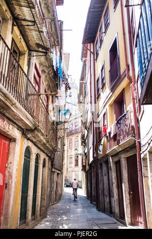 Cycling down Rua Afonso Martins Alho, Porto, Portugal. - Stock Image
