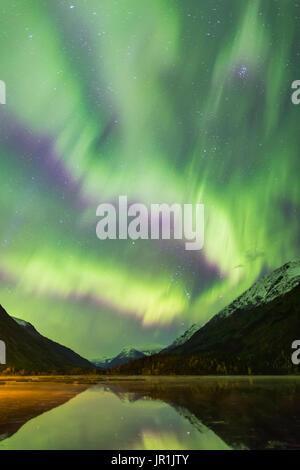 Northern Lights Dance Over Tern Lake And The Kenai Mountains, Southcentral Alaska, USA - Stock Image