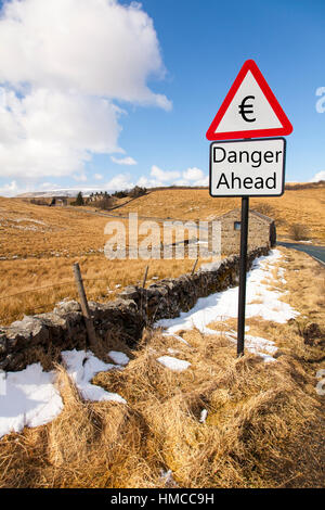 Euro European currency  danger ahead warning sign signs of plummeting currency exchange rate concept sign - Stock Image