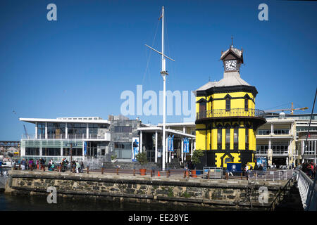 The clock tower at the V&A Waterfront on Cape Town, South Africa, and the Nelson Mandela Gateway to Robben Island - Stock Image
