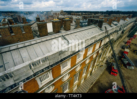 Hampton Court Fire 30 March 1986 Firemen check out the damage the morning after the fire. Fire today gutted a wing of Hampton Court Palace, a country residence of kings and queens dating from the reign of Henry VIII. One person died and  art treasures were damaged. - Stock Image