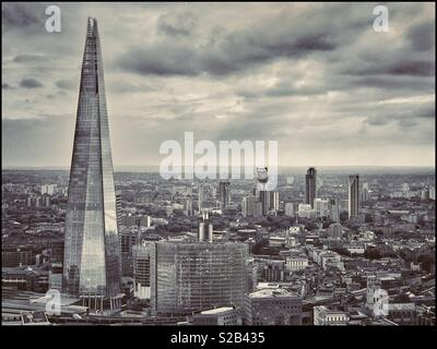 An aerial view of the tallest building in the UK & the EU - The Shard or Shard Of Glass is in Southwark, London. Construction was completed in 2012. It has 96 floors - 72 are habitable. © C.HOSKINS. - Stock Image