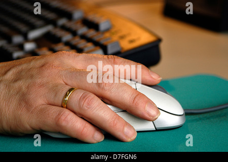 Computer, mouse, hand, keyboard, PC keyboard, hand on mouse - Stock Image