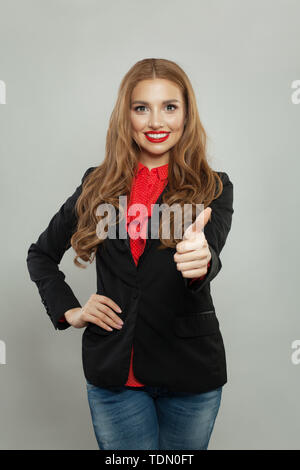 Smart woman showing thumb up on white - Stock Image