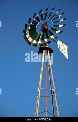 A windmill at the Amish Farm and House in Amish Country, Lancaster County, Pennsylvania, USA - Stock Image