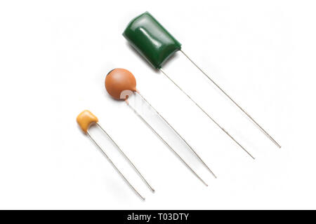 Ceramic capacitors three different types on white background - Stock Image