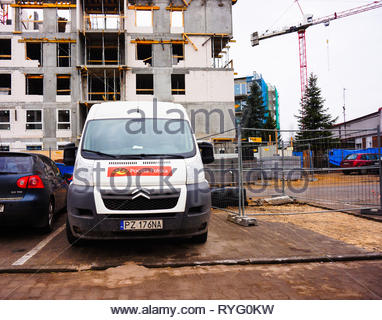 Poznan, Poland - March 3, 2019: Poczta Polksa Citroen delivery van parked on a parking spot in front of a apartment building under construction. - Stock Image