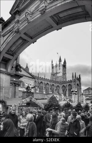 A section of the famous Bath Christmas Market - held in this world famous city in the weeks approaching the Festive Season. In the centre of the picture is Bath Abbey. Photo © COLIN HOSKINS. - Stock Image