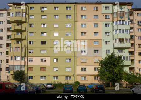 Facade of brutalist architecture of a typical residential block, with mosaic of construction change through time  outside the centre of  Sibiu, Romani - Stock Image