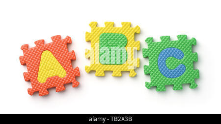 Top view of ABC alphabet foam puzzle pieces on white - Stock Image