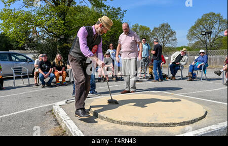 Crawley Sussex, UK. 19th Apr, 2019. Darren Ray from the Handcross 49ers team sweeps the rink before competing in the World Marbles Championship held at The Greyhound pub at Tinsley Green near Crawley in Sussex . The annual event has been held on Good Friday every year since the 1930s and is open to players from around the world Credit: Simon Dack/Alamy Live News - Stock Image