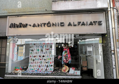 Atelier Antonio Alfaiate storefront and women's fashion illustration in store window with summer dress and hat Porto Portugal Europe EU  KATHY DEWITT - Stock Image