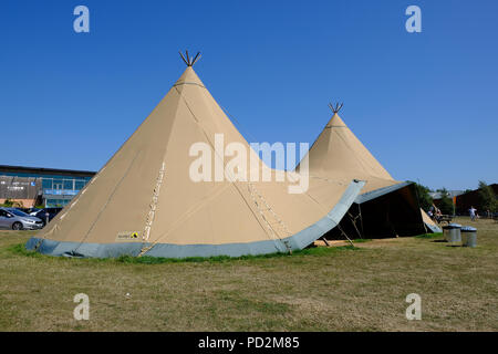Topsham, Devon, UK. A large Nordic Teepee tent is setup at Darts Farm for shoppers to use and enjoy as a picnic spot - Stock Image