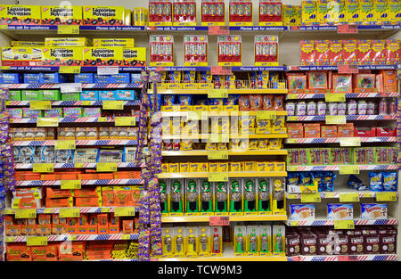 Multiple shelves full of a variety of sweets on display in store. B&M discount store, Bristol - Stock Image