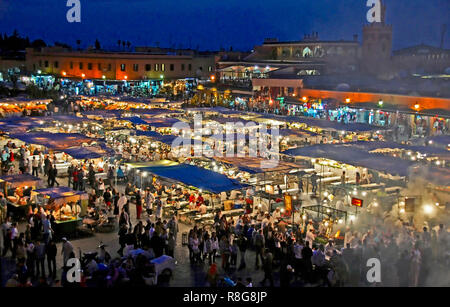 STREET MARKET, JEMAA-EL FNAS, MARRAKECH, MOROCCO. MAY 2011. Medina Old City in the centre of Marrakech in Morocco on an early evening with crowds gath - Stock Image