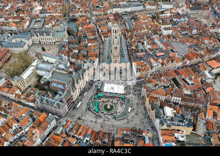 Bruges Aerial City View feat. Belfry of Bruges medieval bell tower historical landmark and iconic Market Square Europe tourist attraction in Belgium - Stock Image