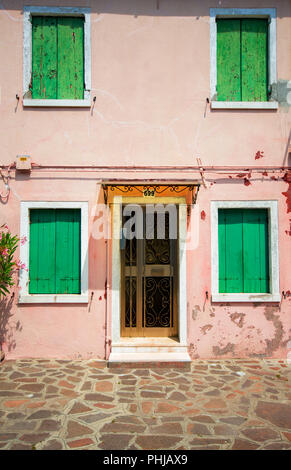 Brightly painted house in Burano, Venice, Italy - Stock Image