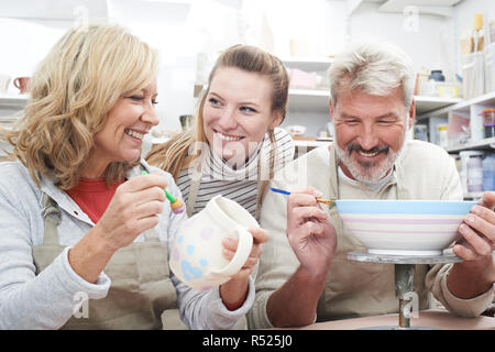 Mature Couple With Teacher In Pottery Class - Stock Image