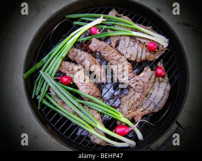 Carne Asada cooking on BBQ - Stock Image