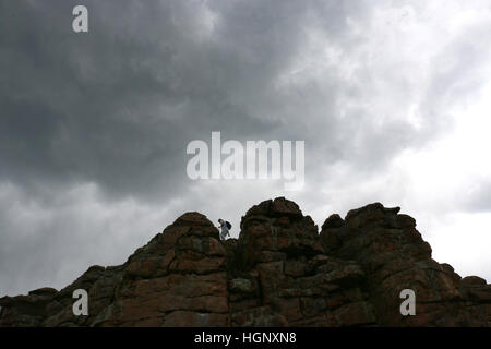 Hiker in storm on Rocky Mountain National Park ridge Colorado - Stock Image