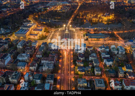 Budapest, Hungary - Aerial view of illuminated Heroes' square at dusk with City Park, Szechenyi Thermal Bath, Vajdahunyad Castle, museums and Andrassy - Stock Image