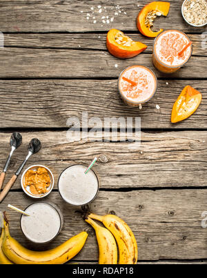 Healthy smoothies with fruits . On a wooden background. - Stock Image