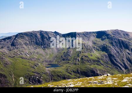 View to Llyn Bochlwyd, Glyder Fach and Y Gribin ridge with Glyder Fawr above Idwal slabs seen from Pen yr Ole Wen - Stock Image