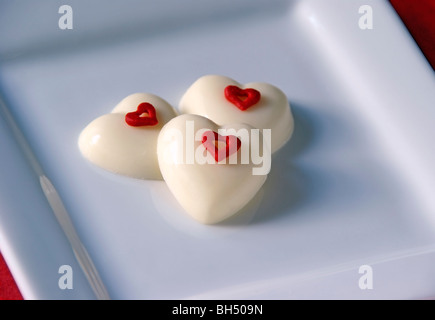 Heart shaped white chocolate candy - Stock Image