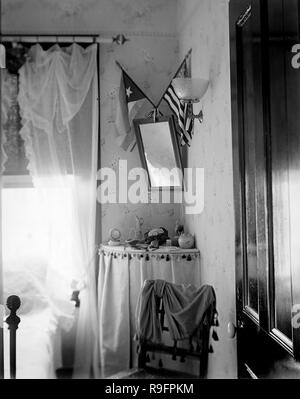 Parlor scene with flags in a turn of the 20th century home. - Stock Image