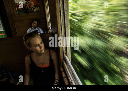 Train travel in Myanmar. (trainline to the bridge over the river Kwai) - Stock Image
