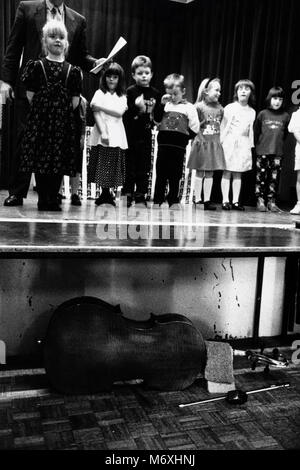 Young children on stage at small eisteddfod in village hall at Y Groeslon Gwynedd North Wales UK - Stock Image