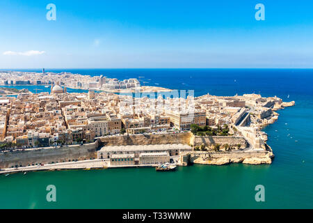 Historical Valetta, capital city of Malta, Grand harbour, Sliema town, Marsamxett bay from above. Skyscraper in Paceville district is in the backgroun - Stock Image
