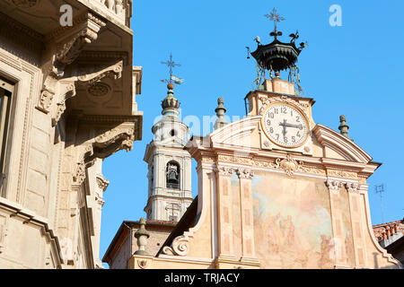 MONDOVI, ITALY - AUGUST 15, 2016: Saint Peter and Paul church clock and bell tower with automaton in a sunny summer day, blue sky in Mondovi, Italy. - Stock Image