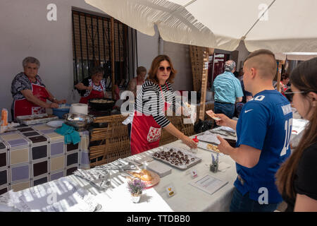 Local market stall selling cherries in chocolate - Stock Image