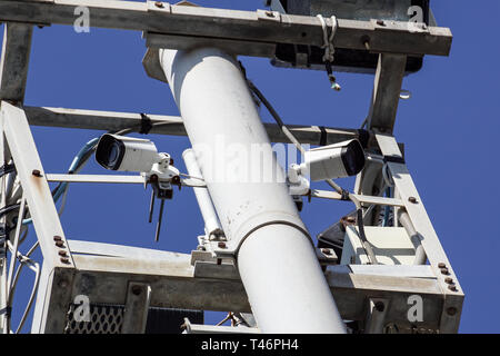 high tower of CCTV camera system in daytime - Stock Image