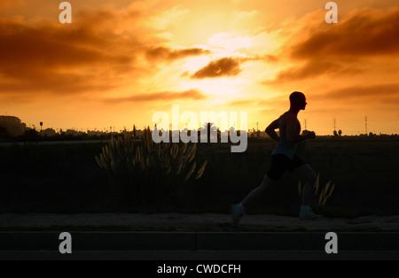 Solo Sunset Runner - Stock Image