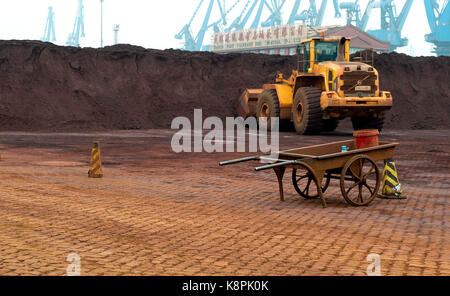Tianjin, Tianjin Municipality, China. 12th Sep, 2014. Iron Ore stockpile storage on the docks in Tianjin Port China. - Stock Image