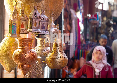 Marrakech souk - people shopping in the souks; the Marrakesh Medina, Marrakech, Morocco, North Africa - Stock Image