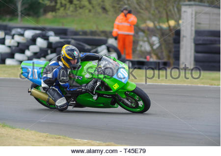 East Fortune, UK. 14 April, 2019. 20 Michael Jamieson riding a Kawasaki ZXR400 in a Scottish Lightweights race at East Fortune Raceway, during the opening rounds of the 2019 Scottish Championships, Melville Open and Club Championships. Credit: Roger Gaisford/Alamy Live News - Stock Image