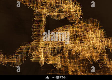 Fairy lights on deciduous trees at night, blurred - Stock Image
