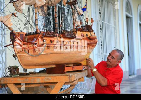 Cuba Cienfuegos Cuban Fidel Lopez works on a model galleon Copyright Christopher P Baker - Stock Image