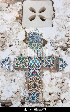 Detail of a Cross on the Facade of a typical Orhtodox Church in Paros, Greece - Stock Image