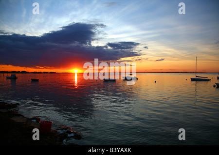 Dramatic sunset over Great South Bay, Fair Harbor, Fire Island, NY, USA - Stock Image