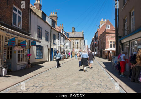 The cobbled street of Church Street in summer. - Stock Image