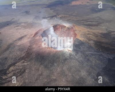 Aerial photo of Halemaumau and part of the Kilauea caldera floor at the summit as the volcano continues to erupt July 17, 2018 in Hawaii. In the lower third of the image, you can see the buildings that housed the USGS Hawaiian Volcano Observatory and Hawaii Volcanoes National Park Jaggar Museum. - Stock Image