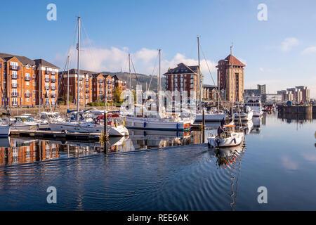 Perfect reflection at Swansea Maritime Quarter Swansea Marina Swansea West Glamorgan Wales - Stock Image