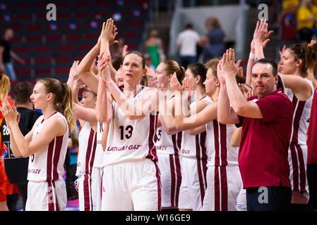 RIGA, LATVIA. 30th of June, 2019. Aija Brumermane (L) and Martins Zibarts (R) , after EuroBasket Women 2019 , game between team Latvia and team Spain in Arena Riga, Riga, Latvia. Credit: Gints Ivuskans/Alamy Live News - Stock Image